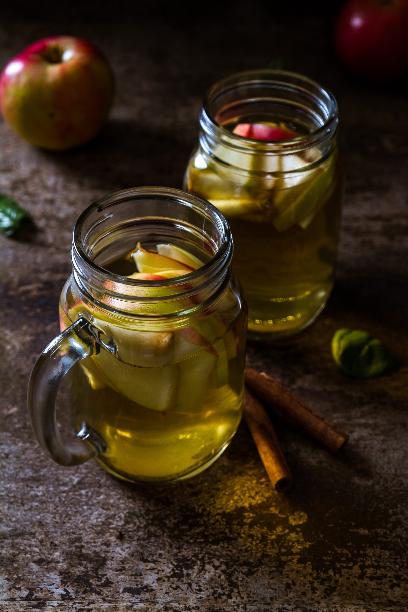 two mason jars with spiked apple cider